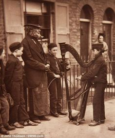 Child labour: The book shows children at work - a common sight in Victorian London. Pictured right is a boot shiner, called an 'independent ...