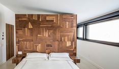 An Abstract Wooden Headboard is a Striking Feature in The Du Tour Residence in Laval, Canada, designed by Architecture Open Form and interior design firm FX Studio par Clairoux Residence Architecture, Form Architecture, Interior Architecture, Interior Design, Prairie Style Architecture, Prairie Style Houses, 1960s House, Bookshelves In Living Room, Living Rooms