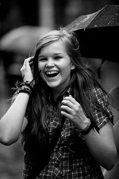 girl laughing in the rain by jonathan mcgonnell, via Flickr