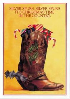 Cowboy Christmas sign -cowboy boots filled with goodies.