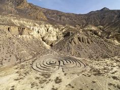 """Labyrinth,"" Nepal This ancient symbol of a maze was constructed in Jonsom, Nepal, in the deepest gorge on earth, near a river held sacred by local people. Though labyrinths around the world may vary in their form, Rogers says they are ""all characterized by a single meandering path leading from a center point to an exit. In both Hinduism and Buddhism, the labyrinth is seen as a path of contemplation for those seeking divine wisdom or peace."""
