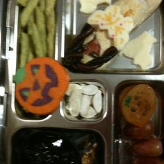 Turkey dog mummy with cheese (cats and breast plate) and fruit twist crown, jack I lantern cookie and apricot, grapes, jello in spider cup, pumpkin seeds, pea pod crisps, grape skewer, and sesame snack