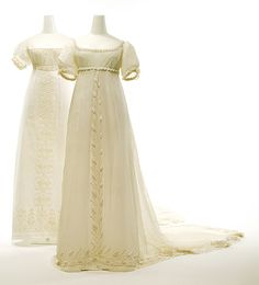 "Two Regency Dresses: ca. 1810, French, white cotton.    ""The combination of white mull, a thin and almost sheer cotton, with a cylindrical silhouette and a high Empire waistline comprises a potent evocation of classical dress. Although there are many images depicting the belting of chitons and peploi above the natural waistline, the raised waist was rarely positioned directly under the bust. This Neoclassical mannerism abetted the illusion of the body as a dramatically linear and columnar…"