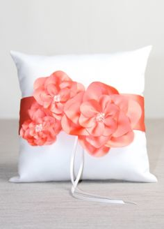 http://www.weddingbells.ca/wp-content/uploads/2012/07/coral-ring-bearer-pillow-Davids-Bridal.jpg