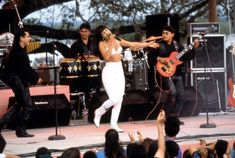 Jennifer Lopez wears white outfit during performance of 'Como La Flor' in 'Selena'.