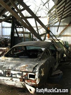 1966 mustang in old shop - Rusty muscle car photos and project muscle cars for sale at RustyMuscleCars.com