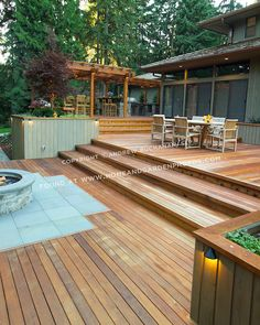 A 1700 square foot, deck, outdoor kitchen, and firepit complete the outside of this ranch-style home tucked among towering fir trees in a Seattle suburb. Design by Sander Groves Landscapes, Inc. Outside Bars, Patio Steps, Ranch Style Homes, Diy Deck, Garden Landscape Design, Outdoor Living, Outdoor Decor, Outdoor Entertaining, Patio Design