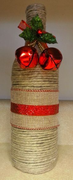 Holiday Inspired Wine Bottle - Wrapped in Natural Polished Hemp Twine, Ribbon, Red Bells and Flowers. - $20