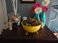 old tin collander that I spray painted and added succulents.