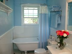 Small Blue & White Bathroom with old refinished Clawfoot tub