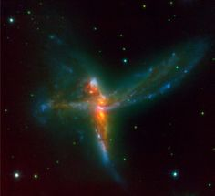 "Stunning image showing the fusion of three galaxies by astronomers called ""The Bird"", this triple galaxy (composed of two massive spiral galaxies and a third irregular galaxy) lies 650 million light years in Sagittarius. The resulting mega galaxy is called Tinker Bell Triplet."