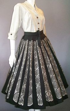 1940's Hand Painted Mexican Circle Skirt & Blouse. This vintage hand painted dress set was made in Mexico by Mocambo. Sash wraps in back, then ties in front — has hook and eyes to keep the sash in place. From blog Here's Looking Like You, Kid.