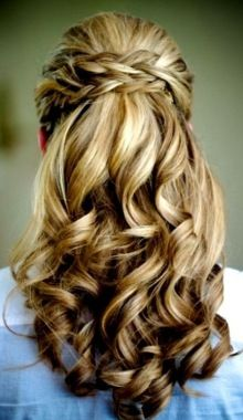 Bride's braided half up waterfall wedding hairstyle