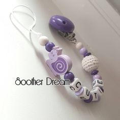 "Personalized Wood Soother clip in purple for baby. Buy now 21 Likes, 2 Comments - SootherDream & Wellness (@sootherdream) on Instagram: ""Pacifier clip - Soother chain $17 Garden Snail & Crochet Ball #Baby #Sootherclip #pacifierclip…"""