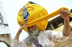 Meet devout Sikh Avtar Singh Mauni - the proud owner of the world's largest turban. He wears the traditional Punjabi turban called a 'pagdi' in the Indian town of Patiala in Punjab, India
