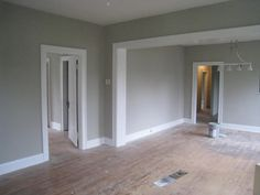 grey walls white trim wood floor -- think about this with the black/espresso cabinets and light counters?