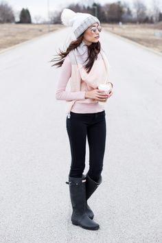 Blush Pink Winter Outfit with a white pompom hat, black matte Hunter boots and a pastel colorblock scarf | College outfit | Pressing Flowers Blog