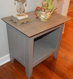A wood grained finish and medium grey with a white wash