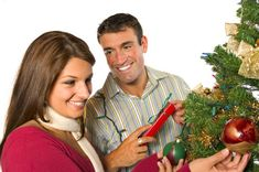 smiling woman receiving a Christmas gift from a man