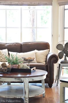 absolutely LOVE this coffee table, and the way the pillows lighten up a dark couch.