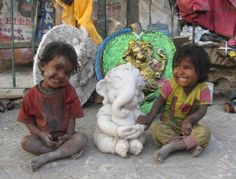 INDIA: Babies of very talented Migrant Sculptors from Rajasthan, living in poverty selling their craft cheaply - on a roadside of 'Millennium City' Gurgaon, with Baby Lord Ganesh: all creations of their family. Dec 14, 2013 Photo by SunjayJK