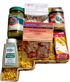 New Mexico is full of spices with a jar of local New Mexico Sweet Hots salsa, a jar of Just Plain Green Chile, a Jar of Chile Salt Seasoning Blend, a bag of Las Cruces Pecan Brittle, Chile Verde Stew Mix and a Hot Chocolate packet from Sunny's Holiday Foods.