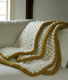 Free Knitting Pattern 11th Hour Blanket - Purl Soho's quick afghan features seed stitch in super chunky yarn doubled with an applied i-cord edge in a contrasting color.