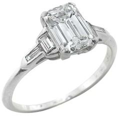 1950s 1.08ct Diamond Engagement Ring. Emerald cut vertical and horizontal baguette diamond on the side. preeety.