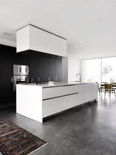 Polished concrete Flooring with white kitchen units