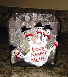 """Elmer's glue spread inside glass sprinkle glitter over it. White handprint outside and paint snowman """"love never melts"""" use old jars or vase for an inexpensive quick craft or gift. Looks so pretty with light candle inside sparkling away."""