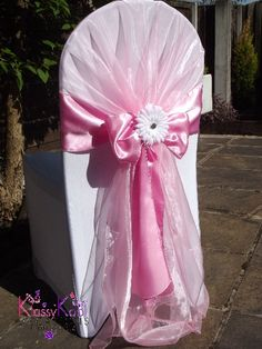 White lycra chair cover with pink organza hood, satin sash bow and white gerbera flower detail. Wedding Chair Sashes, Wedding Chair Decorations, Wedding Table Settings, Wedding Chairs, Wedding Chair Inspiration, Cocktail Table Decor, Folding Chair Covers, Wedding Reception Venues, Receptions