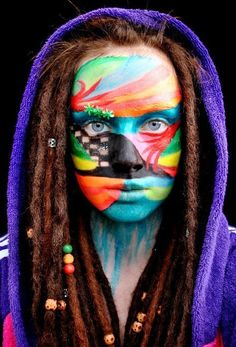 Beaded dreadlocks and super awesome facepaint. #festival #inspiration