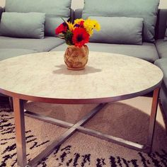 "My IKEA hack life! I took a Rissna coffee table that I bought in the ""As-Is"" department at IKEA Brooklyn, painted the legs metallic silver, and covered the top with marble contact paper."
