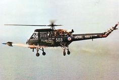 ClassicNavalAir Royal Navy Westland Wasp HAS.1 fires an AS.12 missile, 1960s.