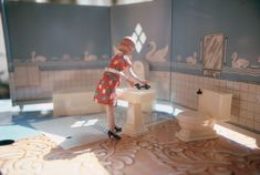 "Laurie Simmons, ""First Bathroom/Woman Standing"" from ""Interiors,"" 1978. Cibachrome print, 3 1/2 x 5 in. Courtesy the artist"