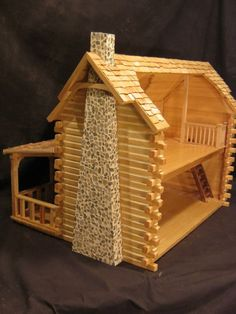 Here is my latest dollhouse. It& the Shenandoah by Dura Craft. This kit is no longer manufactured, though the construction method is . Popsicle House, Popsicle Stick Houses, Popsicle Stick Crafts, Craft Stick Crafts, Wood Crafts, Cabin Dollhouse, Wooden Dollhouse, Dollhouse Miniatures, Miniature Furniture