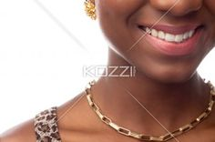 cropped image of a smiling young female fashion model. - Cropped image of a smiling young african american female fashion model, Model: Samara Powder