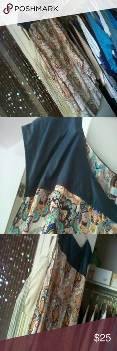 WD.NY Tunic Hi /Low tunic with faux leather shoulders.  It's really long in the back.  I'm 5'2 and it almost reaches the ground.  100% rayon flowy and soft with great pattern. The shoulders are navy.  It will get you noticed.  Worn once.  Thanks for stopping by! WD.NY Tops Tunics