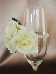 The mother of the bride will have a wrist corsage of ivory spray roses, with bits a seeded eucalyptus and fresh rosemary.