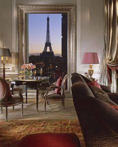 No, that isn't a painting - it's the floor to ceiling window of the Eiffel Suite in the newly renovated Hotel Plaza Athenee in Paris