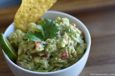 """I am confident that this is the BEST Guacamole recipe you'll make. At least in my house it's the best. 🙂 The BEST Guacamole Recipe I can't tell you how in the world I came up with this, but somehow it """"worked."""" My husband and I love to experiment in the kitchen on Sunday's with new recipes, and this guacamole was born in result of"""