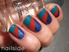 """Rays of Color by Nailside. """"The basecolor I used is H&M Deep Deep Water. It's such a simple yet pretty color, and the fact that it covers in one coat makes it even better! On top I made the red part with Essence Wild Thing (an oldie!), and the turquoise tips with Essence Bella. As usually tape was my little helper for those clean edges. ;-) """""""