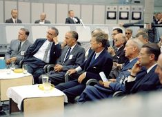 Kennedy listens to a presentation during a tour of Cape Canaveral, Florida, on Sept. 11, 1962.