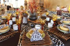 Traditional african wedding decor. Zulu wedding. Wedding ideas. Wedding centerpieces. Luxurious animal prints. Hand painted jugs. Tiffany chair tie backs. Lounge furniture. www.secundatents.com