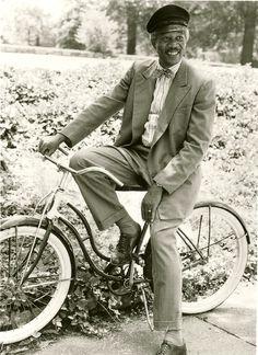Morgan Freeman relaxes on a bike.