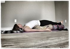 Our customer, Katie Overcash, demonstrating a restorative bridge pose with Inner Space Oval Bolsters.