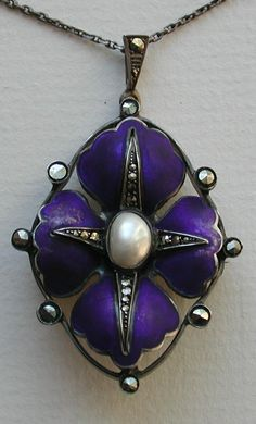 Fahrner Transitional Pendant/Brooch   Circa 1915-1919, beautiful transitional (Edwardian to Deco) original Fahrner brooch/pendant.  Royal blue enameling set with marcasites surrounding a pearl.