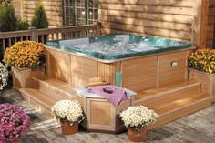 The safest spot for a spa is on the lower level of a deck.