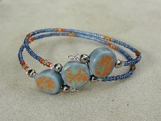 Memory wire bracelet, wrap bracelet with three handmade porcelain (ceramic) beads, blue, orange, green. #EasyNip