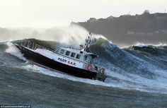 violent waves uk | Riding high: This 48ft ship flies up a wave during a training exercise ...